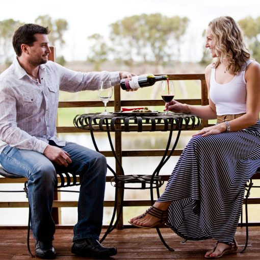 Couple drinking wine at Bettenay's winery